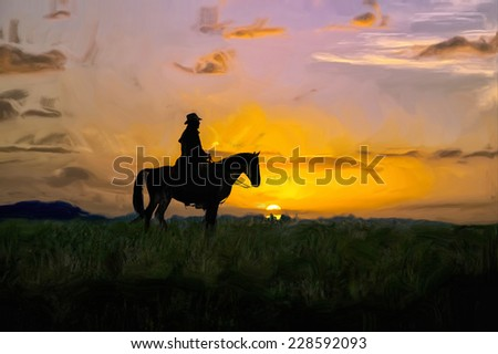 Montana cowboy on the range at first light - stock photo