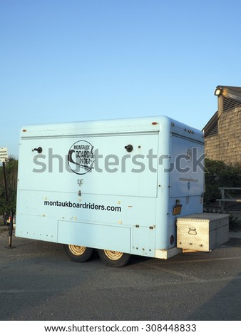 MONTAUK, NEW YORK-JUNE 23: A trailer for Montauk Board Riders surfing school is seen parked in lot  Ditch Plains beach,  the best surfing beach on the east coast of America on June 23, 2015. - stock photo