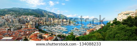 Monte Carlo city panorama. View of luxury yachts and apartments in harbor of Monaco, Cote d'Azur. - stock photo