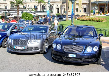 MONTE CARLO, MONACO - AUGUST 2, 2014: British luxury cars Bentley Continental GTC and Bentley Continental Flying Spur at the city street near the casino. - stock photo