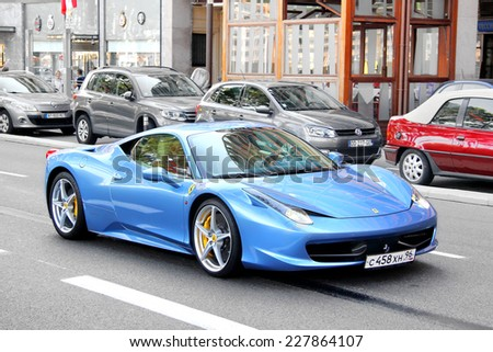 MONTE CARLO, MONACO - AUGUST 2, 2014: Cyan supercar Ferrari 458 Italia at the city street. - stock photo