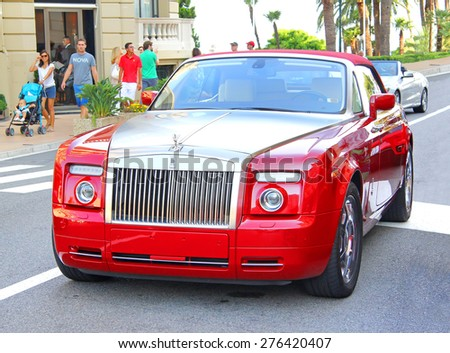 MONTE CARLO, MONACO - AUGUST 2, 2014: Modern luxury car Rolls-Royce Phantom Drophead Coupe at the city street. - stock photo