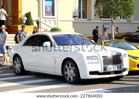 MONTE CARLO, MONACO - AUGUST 2, 2014: White luxury car Rolls-Royce Ghost at the city street near the casino. - stock photo