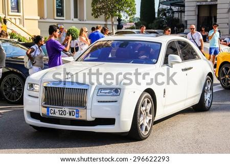MONTE CARLO, MONACO - AUGUST 2, 2014: White luxury car Rolls-Royce Ghost at the city street near the casino. - stock photo
