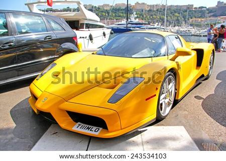 MONTE CARLO, MONACO - AUGUST 2, 2014: Yellow supercar Enzo Ferrari at the city street. - stock photo