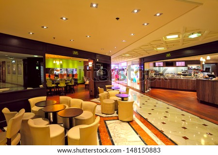 MONTE CARLO, MONACO - JULY 13: Indoor restaurant in Metropole Shopping Center with luxury shops and boutiques is one of the popular resorts and places to visit in Monte Carlo, Monaco on July 13, 2013. - stock photo