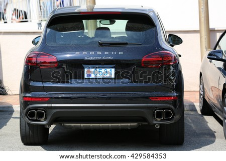 Monte-Carlo, Monaco - May 18, 2016: Luxury Black SUV Porsche Cayenne Turbo Parked in Front of the Fairmont Monte Carlo Hotel - stock photo