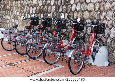 MONTE CARLO, MONACO - NOVEMBER 2, 2014: Row of electric bicycles in the parking lot - stock photo