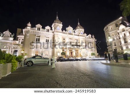 MONTE CARLO, MONACO - OCTOBER 2, 2011 : view of Monte Carlo casino at night. The casino was opened in 1856 when the reigning family of Monaco was almost bankrupt. Photo taken on October 2, 2011.  - stock photo