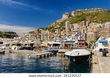 MONTE CARLO, MONACO - SEP 19: View on Port Hercules with luxurious yachts on September 19, 2013 in Monte Carlo, Monaco. IThe port has been in use since ancient times - stock photo