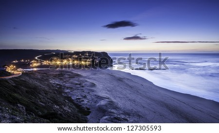 Monte Clerigo beach and village at dusk, Aljezur, Algarve, Portugal - stock photo