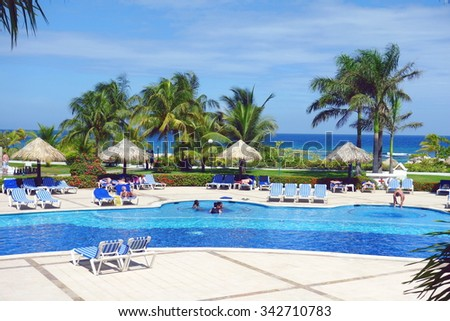 MONTEGO BAY, JAMAICA - SEPTEMBER 10, 2015: Exclusive resort grounds and swimming pool in Montego Bay, Jamaica.  - stock photo