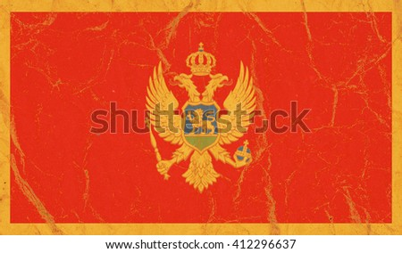 Montenegro flag painted on crumpled paper background - stock photo