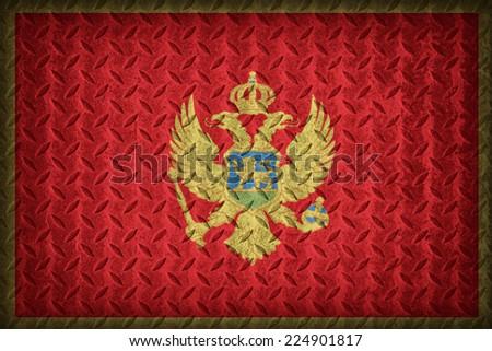 Montenegro flag pattern on the diamond metal plate texture ,vintage style - stock photo