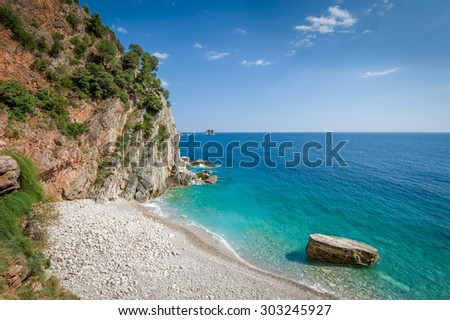 Montenegro wild beach landscape. View from the famous touristic walking path in Petrovac city, Montenegro - stock photo