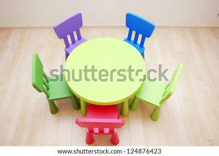 Montessori Kindergarten Preschool Classroom with table and chairs from above - stock photo