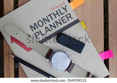 Monthly notebook planner - stock photo