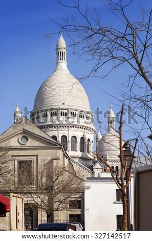 Montmartre, narrow street overlooking a Basilica of Sacre-Coeur, Paris, France - stock photo