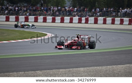 MONTMELO, SPAIN - MAY 10: Ferrari participates in the Spanish Grand Prix on May 10, 2009 in Montmelo, Spain.  Felipe Massa finished in 6th place and Kimi Rikknen did not finish. - stock photo