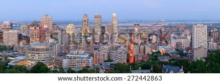 Montreal at dusk panorama with urban skyscrapers viewed from Mont Royal - stock photo