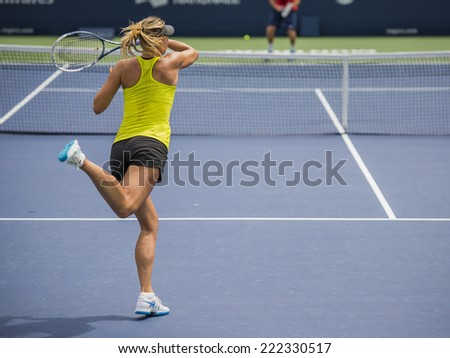 MONTREAL - AUGUST 1: Maria Sharapova of Russia at a practice session at the 2014 Rogers Cup on August 1, 2014 in Montreal, Canada - stock photo