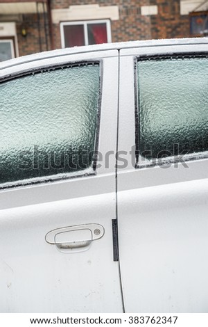 Montreal, CA, 29th February 2016. Car windows are covered with ice after icy rain. - stock photo