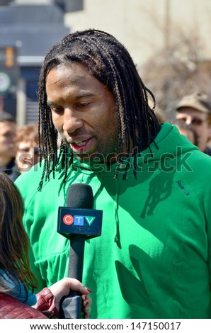 MONTREAL CANADA APRIL 22: Georges Laraque at the Earth Day parade . On april 22 2013 in Montreal Canada. Georges Laraque is a retired Canadian professional ice hockey forward. - stock photo