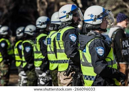MONTREAL, CANADA   APRIL 02 2015: Riot in the Montreal Streets to counter the Economic Austerity Measures. Closeup of Police Gear and Protections - stock photo