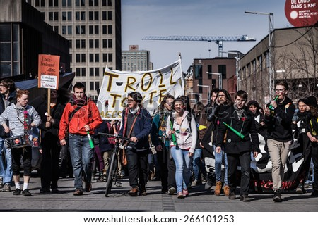 MONTREAL, CANADA  APRIL 02 2015: Riot in the Montreal Streets to counter the Economic Austerity Measures. View of the First line of Protesters walking in the Street - stock photo