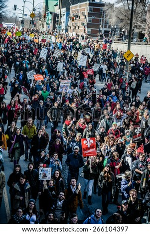 MONTREAL, CANADA   APRIL 02 2015: Riot in the Montreal Streets to counter the Economic Austerity Measures. Top View of the Protesters Walking in the Packed Streets - stock photo
