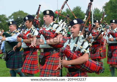 MONTREAL CANADA AUGUST 03: Black Watch Pipes and Drums are the oldest organized pipe band in North America, consistently ranked among the top Canadian Forces bands. on 08 03 2014 in Montreal Canada. - stock photo