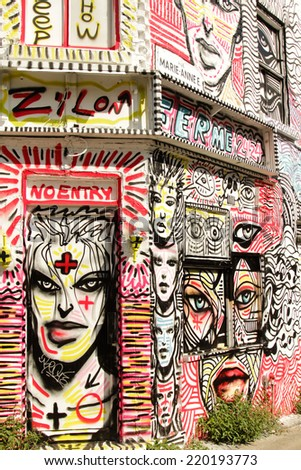 MONTREAL  CANADA - AUGUST 20:  House painted during Mural festival by Zilon, emblematic figure of montreal graffiti on august 20, 2014 in MONTREAL - stock photo
