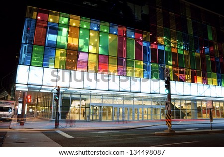 MONTREAL, CANADA - AUGUST 19: Montreal Convention Centre (Palais des Congres de Montreal) with its colorful glass facade by night on August 19, 2008 in Montreal, Canada. - stock photo