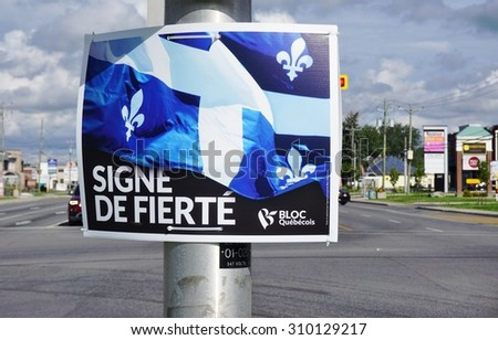 MONTREAL, CANADA -22 AUGUST 2015- Poster reading Signe de Fierte (sign of pride) for the Bloc Quebecois, a federal political party in Canada defending the sovereignty of Quebec.  - stock photo