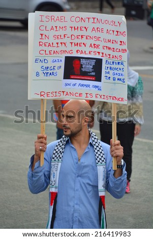 MONTREAL CANADA AUGUST 21:Unidentified palestinian man participating in a rally to condemn the Israel occupation an bombing on Gaza On 08 21 2014 in Montreal Quebec Canada - stock photo