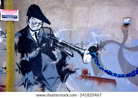 MONTREAL CANADA DEC 27: Street art Montreal trumpet player on dec 27 2014 in Montreal Canada. Montreal. is the perfect place to walk in the back alleys and abandoned areas, looking for street art. - stock photo