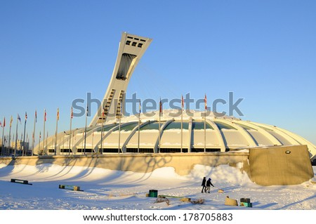 MONTREAL,CANADA -FEB.16.The Montreal Olympic Stadium and tower on February 16 , 2013. It's the tallest inclined tower in the world.Tour Olympique stands 175 meters tall and at a 45-degree angle - stock photo