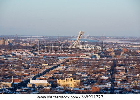 MONTREAL, CANADA - JAN 16: Early evening light on the Olympic Stadium, Montreal. View of the city from Mont Royal. On January 16th 2015 in Montreal  - stock photo