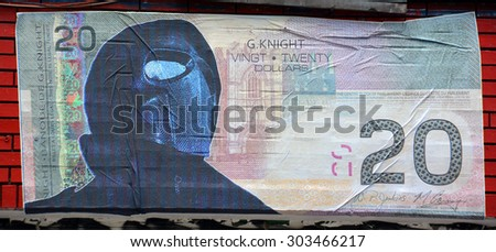 MONTREAL CANADA JULY 25 2015: Street art 20$ of Republic of G.Knight New World Currency. Montreal is the perfect place to walk in the back alleys and abandoned areas, looking for street art. - stock photo