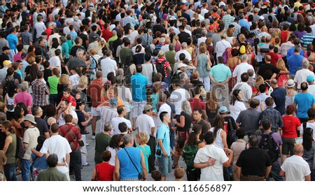 MONTREAL, CANADA - JUNE 29: People walk during the open-air concert at the 33th International Jazz Festival of Montreal on June 29, 2012 in Montreal, Canada - stock photo