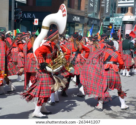 MONTREAL CANADA MARCH 22: Scottish band participants at the annual Saint Patrick's Day Parade on march 22 2015 in Montreal Canada. Montreal St. Patrick's Parade has run consecutively since 1824  - stock photo