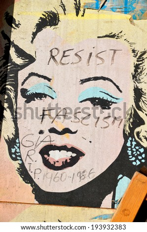 MONTREAL CANADA MARCH 30: Street art Marilyn Monroe on march 30 2014 in Montreal Canada. Montreal. is the perfect place to walk in the back alleys and abandoned areas, looking fo street art. - stock photo