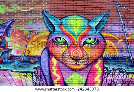 MONTREAL CANADA MARCH 30: Street art Montreal cat on march 30 2014 in Montreal Canada. Montreal. is the perfect place to walk in the back alleys and abandoned areas, looking street art.  - stock photo