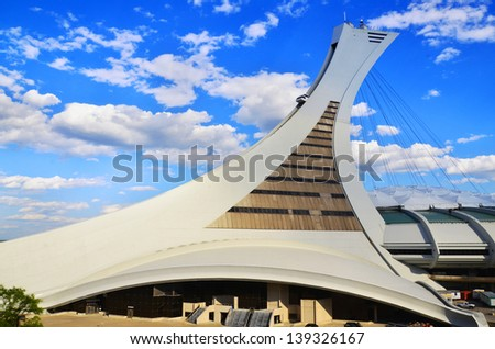 MONTREAL CANADA MAY 19: The Montreal Olympic Stadium and tower on May 19 2013. It's the tallest inclined tower in the world.Tour Olympique stands 175 meters tall and at a 45-degree angle - stock photo