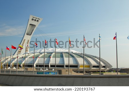 MONTREAL  CANADA - SEPT 05: Olympic stadium with international flags on september 05, 2014 in MONTREAL - stock photo