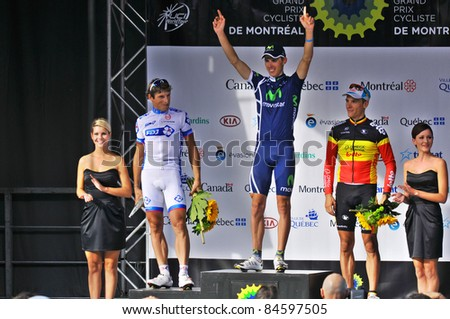 MONTREAL, CANADA-SEPTEMBER 11:Podium 1 Alberto Rui Faria Da Costa , 2 Frederico Pierrick and 3 Gilbert Philippe at the 2011 Grand Prix Cycliste de Montréal on September 11, 2011 in Montreal, Canada - stock photo