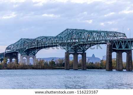 Montreal Champlain Bridge above St. Lawrence River early in the morning (1) - stock photo