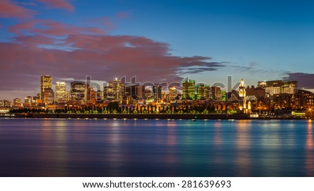 Montreal city skyline over Saint Lawrence River at twilight with urban buildings, Montreal, Quebec, Canada - stock photo