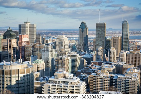Montreal Financial District in winter, as seen from Mont Royal. Downtown district with St Lawrence River in the background. Early evening light. - stock photo
