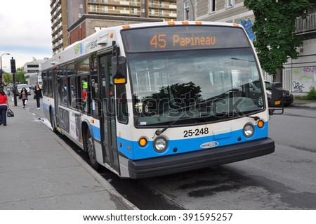 MONTREAL - JUN 8: Montreal Express Bus #45 on June 8, 2012 in downtown Montreal, Quebec, Canada. - stock photo